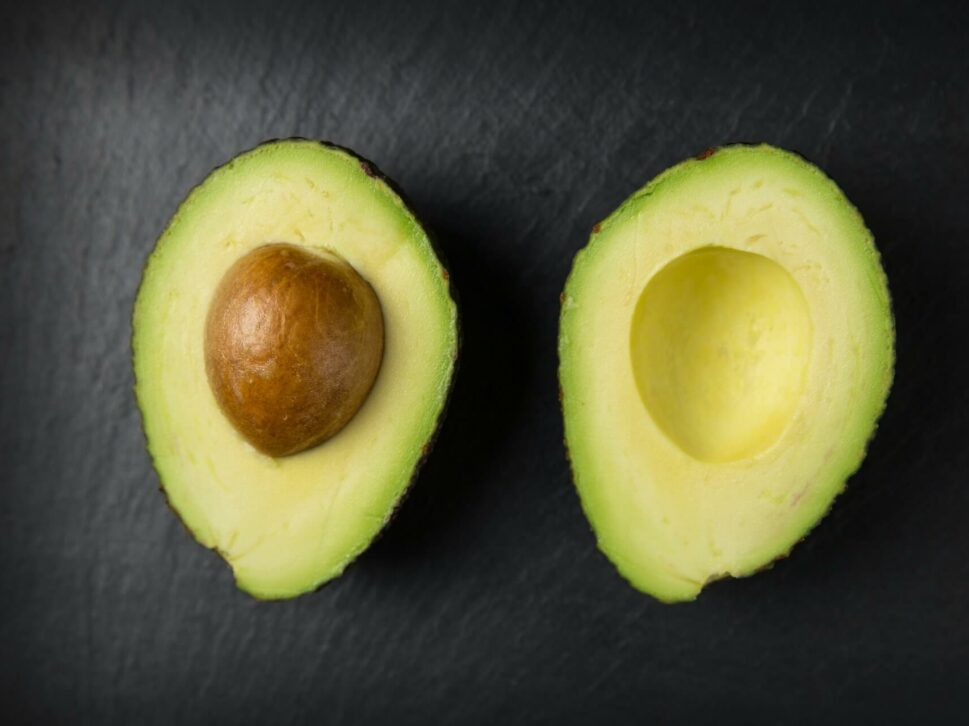 sliced avocado that shows the pit