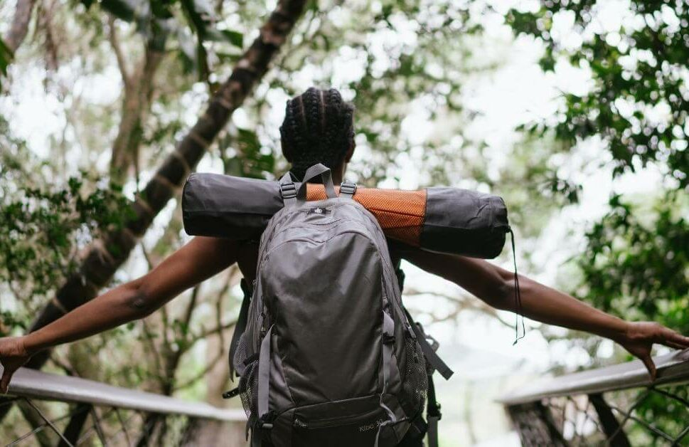 woman on backpack over-looking nature